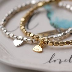 Our gorgeous gold and silver plated brass bracelets features a sweet heart among the tiny nuggests. The perfect gift for any special girl. Our gold and silver plated bracelet is so sweet, It is a gor. Heart Bracelet, Bangle Bracelets, Bangles, Vintage Jewelry, Handmade Jewelry, Bridal Gifts, Organza Bags, Personalized Gifts, Women Jewelry