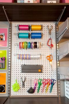 craft room organization: Pegboard for storing craft supplies and ribbon