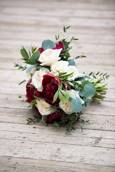 Deep red peonies mixed with lush eucalpytus foliage and romantic White O'Hara garden roses for our spring bride! www.flowersbyjanie.com Calgary Wedding Florist Photo: @EmilyExon