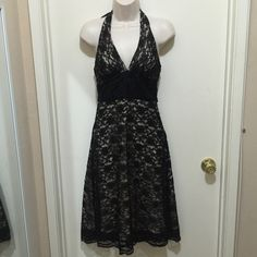 "Black lace dress Gorgeous halter lace dress from White House, Black Market. Fully lined. In excellent condition. Length: 42"" Open to offers. White House Black Market Dresses Midi"