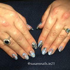 Lavender blue gel nails and pink roses