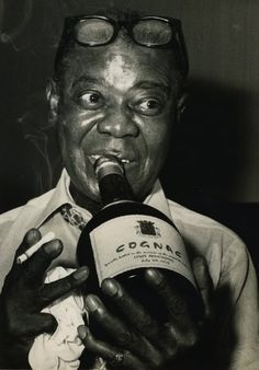 a biography of louis armstrong an american singer The full biography of louis armstrong, including facts, birthday, life story, profession, family and more.