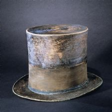 The top hat the Abraham Lincoln was wearing in Ford's Theatre, the night he was assassinated on April 14, 1865.  The hat has a black silk mourning band which was added in remembrance of Lincoln's son Willie.    This hat was transferred from the War Department to the Patent Office, with permission from Mary Lincoln, in 1867.  The Patent Office then transferred the hat to the Smithsonian Institution which immediately placed the hat in a basement storage room.  The American public didn't see…