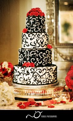 black and white cake with red accents