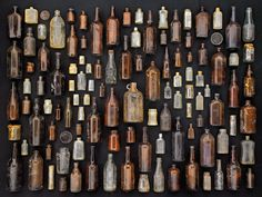 "Old bottles (Brown and clear glass bottles on black background. Found objects collected on Floyd Bennett Field, Brooklyn, New York. From the series of photographs ""Found in Nature"" by Barry Rosenthal. Antique Glass Bottles, Vintage Bottles, Bottles And Jars, Brown Bottles, Beer Bottles, Vintage Perfume, Glass Jars, Perfume Bottles, Collections Of Objects"