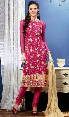 Pink chanderi cotton silk suit with contrast dupatta makes perfect combo for evening party. The suit is embellished with golden woven lace, contrast cream silk thread embroidered border and scattered floral motifs, crystal stones, stand collar and potli buttons which gives you an elegant look. The contrast cream chiffon dupatta has golden woven lace. The suit comes with matching churidar. #AttractiveCasualChuridarSuit