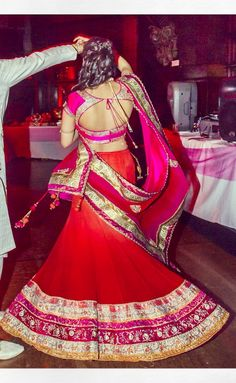 Orange and pink outfit #engagement #indian bride to be