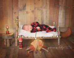 newborn Precious baby photography  Angela Forker unique Fort Wayne New Haven Indiana  fun whimsical adorable baby boy rustic bed branches thermos fire flames lamp lumberjack camping campfire roasting marshmallows funny cute hilarious
