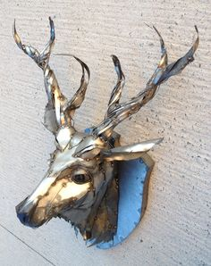 Deer head , metal art sculpture 2 feet x 3 feet x 16 inches The blue is just a reflection it is all steel. $950 Cdn. by Joel Sullivan irondesigns@live.ca