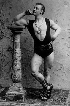 """The handsome Hebrew: Eugen Sandow. Born Friederich Wilhelm Mueller on April 2, 1867. He began his career as a sideshow """"strongman."""" Early in life, and with the help of showman Florenz Ziegfeld, Sandow decided it wasn't enough to simply demonstrate his strength, but to actually display his muscular physique as though it were a work of art. He soon made his """"Muscle Displays"""" the main feature of a Vaudeville stage show and at the Chicago Worlds Fair."""