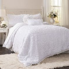 Highlighted by ornate floral embroidery, this elegant comforter set outfits your bed in inviting style.      Product: