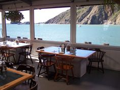These are the glass top bottomless tables that you can see through to the ocean at Olde Port Inn