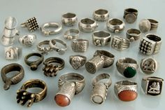 Africa   A collection of rings worn in Ethiopia (Amhara, Tigray, Oromo, Harar, Rashaida) Eritrea and Sudan   Silver, bronze, carnelian and glass   This collection highlights the various found within the region.  For example the Rashaida mainly wear silver (sometimes set with semiprecious stones or glass), the Oromo from Sidamo region prefer brass/bronze, the Kafa region integrate geometric patterns, Tigray & Amhara rings incorporate symbols as the Lion of Judas.