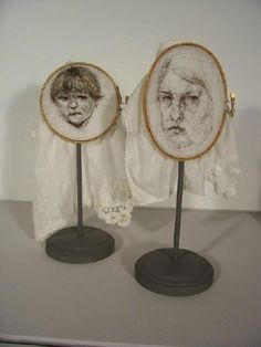 Leslie Schomp, SELF PORTRAIT WITH SON (2007), hair and nylon thread on found handkerchiefs, embroidery hoops