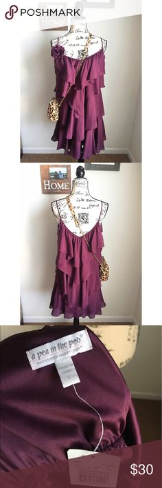 NWT A Pea in the Pod Maternity Dress NWT maroon maternity dress. This dress is GORGEOUS! It hits right at the knee and I'm 5'9. No imperfections! Price is firm on single items so bundle to save! Automatic 15% off 3 or more! Feel free to bundle anything and make an offer. A Pea in the Pod Dresses Midi