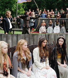 I love the expressions on their faces, like they all comparing notes on the archers.