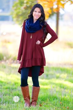 """Treat yourself this season with the Grace Ruffle Tunic! The long design and ruffles hug your body in all the right places to create the ultimate flattering look for all body types. Pair with your White Plum Cable Knit Fleece Leggings and a pendant necklace and you've got a timeless look to last you all season.Colors Available BlackBurgundyCharcoalTealSizes Available Small (0-4)Medium (6-8)Large (10-12)Women's SizingModel is 5'7"""" - wearing size smallRayon/spandex blendHand wash co..."""
