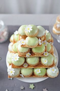 Substitute ableskivers with cream filling and cover with white chocolate candy melts tinted green or pink.  Top with royal frosting daisy.