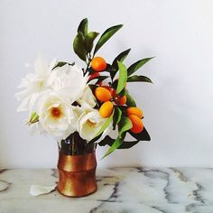This is the most gorgeous arrangement. White flowers and citrus…can't go wrong.