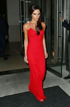 Victoria Beckham, who was accompanied by son Brooklyn, looked radiant as she switched up her style in favour of a bright red floor-length number that clung to her frame and showed off her toned shoulders and arms at the 2015 Glamour Women of the Year Awards.