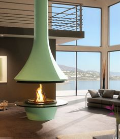 This highly modern mint green 992 Eva Central Fireplace is by French company JC Bordelet. If The Jetsons had a fireplace, this would be i...