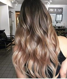 Muted Rose-Gold Balayage for Long Wavy Layered Hair