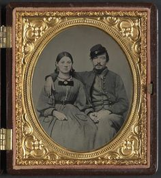 Confederate soldier and his sister, sweet poise, note her hair is short....
