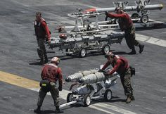 ARABIAN GULF (July 4, 2013) – Aviation ordnancemen transport ordnance across the flight deck of the aircraft carrier USS Nimitz (CVN 68). Nimitz Strike Group is deployed to the U.S. 5th Fleet area of responsibility conducting maritime security operations, theater security cooperation efforts and support missions for Operation Enduring Freedom. (U.S. Navy photo by Mass Communication Specialist Seaman Apprentice Kelly M. Agee/ Released)