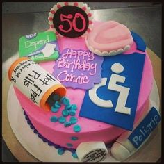 Old people cake, with pills, poligrip, handicap sign,etc. by www.thebluecakecompany.com