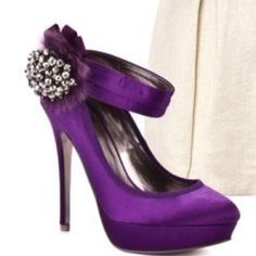 These purple shoes are Elegant Beautiful, & Magnificent!I love the little cluster of pearls off to the side. They really add a special something to the shoes. I LOVE them!!..K♥