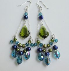 42f90589493 Sofia ...peacock inspired olivine green baroque Swarovski crystal and pearl  chandelier earrings in silver