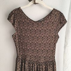 Patterned Scoop Neck Dress Chocolate colored dress with light brown patterned accents all over. Dress is a soft, light weight, 100% polyester material that stretches. BeBop Dresses Mini