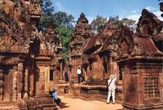 Discover the enchanting temple of the Banteay Srei which means 'Citadel of the Women' and it is said that it must have been built by a women, as the elaborate carvings are too fine for the hand of a man.