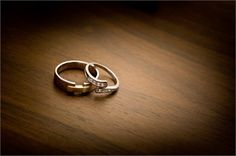 I like this idea. The rings casually lying on a dresser together. It almost tells a story about their busy day, or perhaps the long amount of time spent planning the big day and now they wait to walk down the isle.