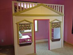Darling loft bed!!  At Pottery Barn the same bed is thirteen hundred dollars.  Here are plans to build it yourself.  Do I dare try to build it?