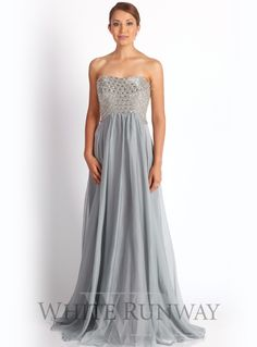 Indigo Embellished Dress. An elegant full length dress by Jadore. A strapless style featuring an embellished bodice and flattering skirt with pleats.