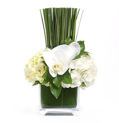 a mini #floral arrangement in a glass cube but makes such a statement!  I love the grass. #wedding