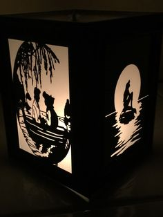 Beautifully handcrafted decorative lantern. Inspired by The Little Mermaid. Made with repurposed frames and hand cut silhouettes. Making each
