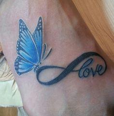 Butterfly/infinity symbol tattoo from Club Tattoo in Las Vegas