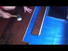 This is a video on how to install engineered hardwood flooring using the lock and fold method instead of floating with adhesive.