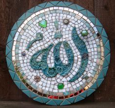 diameter - MDF base handmade ceramic lettering in Arabic - Allah meaning God Glaze fused with glass and fired. materials used: ceramic tiles with mirror on surround, vireous glass mosaic tiles with glass nuggets & recycled jewellery on inside. Mirror Mosaic, Glass Mosaic Tiles, Mosaic Projects, Mosaic Ideas, Allah Calligraphy, Allah Names, White Mirror, Allah Islam, Recycled Jewelry