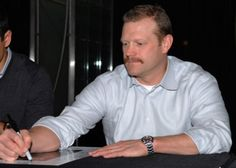mmm...Tim Thomas. i'd like to touch his moustache.