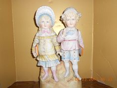 Large Bisque Figurine of Victorian Boy and Girl from marysantiquedolls on Ruby Lane