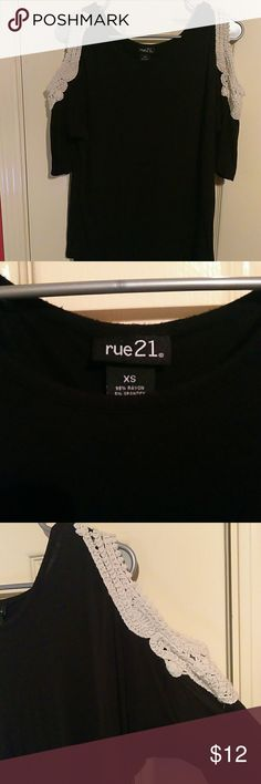 Cold shoulder top Black stretchy material with off white crochet opening on the closure. From rue 21. Size xs but could fit up to a medium. Very comfy. Lightly worn. Rue21 Tops Tees - Short Sleeve