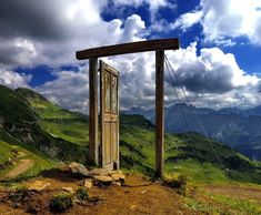 surreal door to nowhere spotted in the Alps