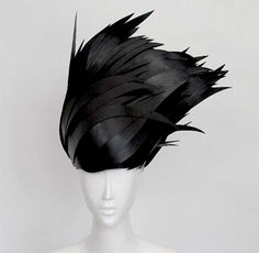 The Paper Cut Project features original Paper Wigs and other creative works