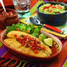 An egg and garlic batter, a spicy cornmeal breading and a topping of pico de gallo all enhance this mild-tasting white fish. #fish #seafood