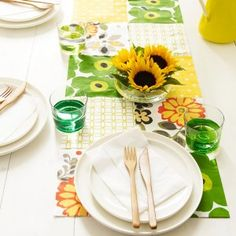 DIY Table Runner from Napkins - they use inexpensive paper napkins and tape on the backside.  Use others to make banner by draping over a line.