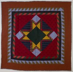 Both the pattern and fabrics make this truly a one of a kind Center Medallion Feathered Star Quilt. Deep, intense color combinations make it...