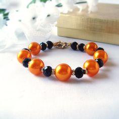 Bright OraneBracelet with Black Glass Rhonelles Beads and Tiny Rhinestone Rondelles